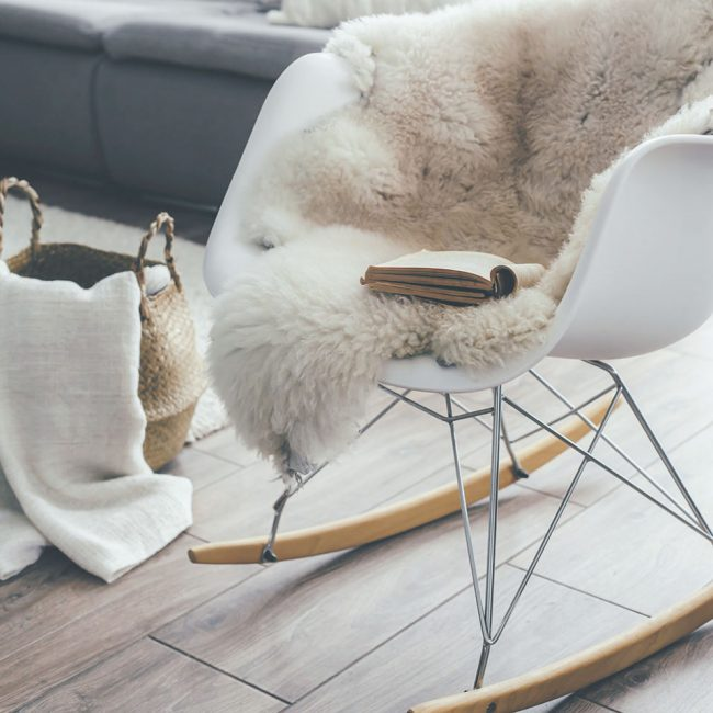 Rocket chair with sheep skin rug in scandinavian living room